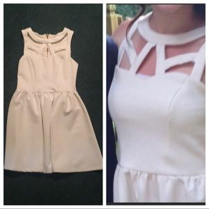 Super cute  and unique cream dress with cut outs